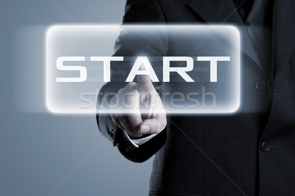 Stock photo: Start button pressed by businessman