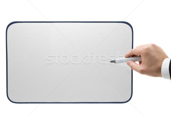 Pointing onto whiteboard Stock photo © ShawnHempel