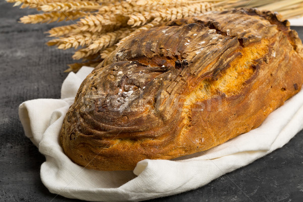 Hand made bread loaf with wheat ears Stock photo © ShawnHempel