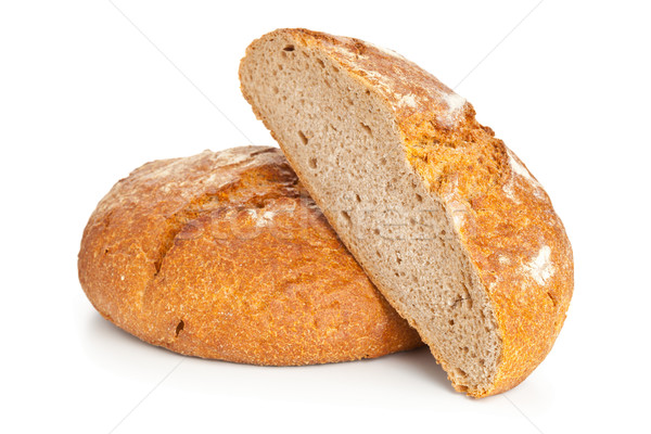 Cut loaf of bread on white Stock photo © ShawnHempel