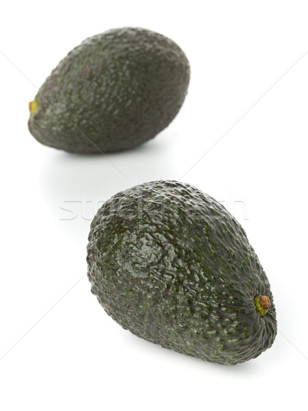 Two whole, uncut ripe avocado fruit Stock photo © ShawnHempel