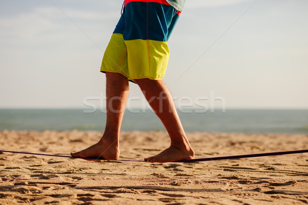 teenage balancing on slackline with sea view Stock photo © shevtsovy