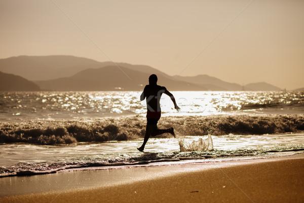 man run into the sea Stock photo © shevtsovy
