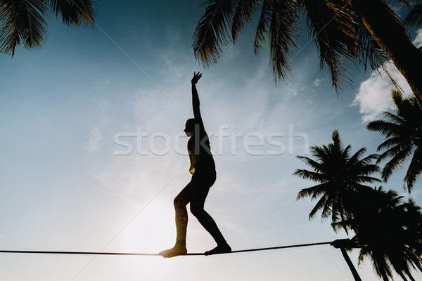 teenage girl  balancing on slackline with sky view Stock photo © shevtsovy