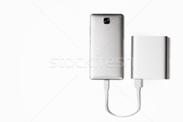 powerbank charge smartphone isolated white Stock photo © shevtsovy