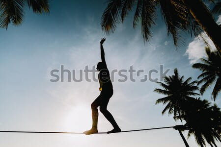 teenage balancing on slackline with sky view Stock photo © shevtsovy