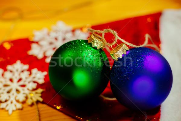 új év labda hópelyhek ünnep piros fa Stock fotó © shevtsovy