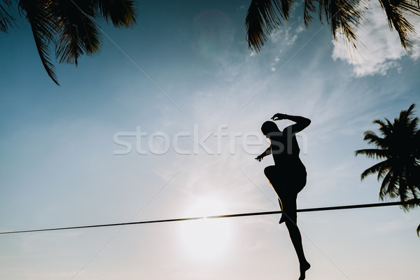 teenage jumping on slackline with sky view Stock photo © shevtsovy