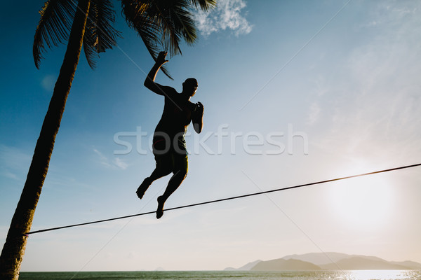 teenage balancin on slackline with sky view Stock photo © shevtsovy