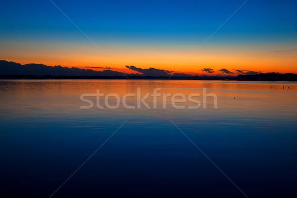 Puesta de sol dragón cabeza como nubes lago Foto stock © shihina