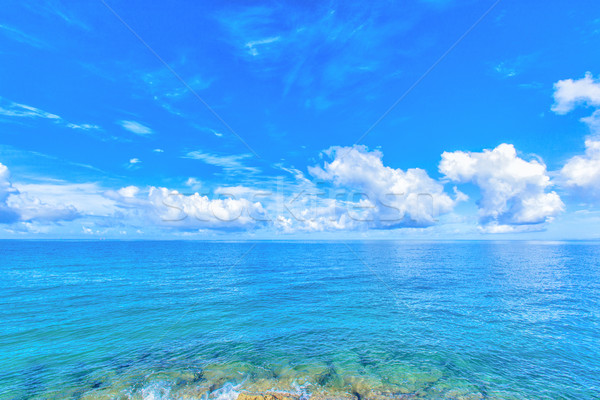 Clouds and blue ocean, tropical island Stock photo © shihina