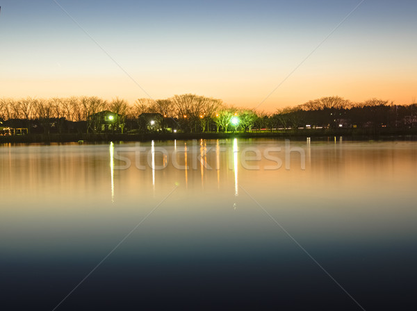 Reflection of sunset glow on the park pond, HDR Stock photo © shihina