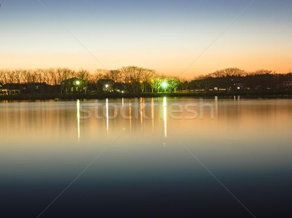 Tükröződés naplemente izzik park tavacska hdr Stock fotó © shihina