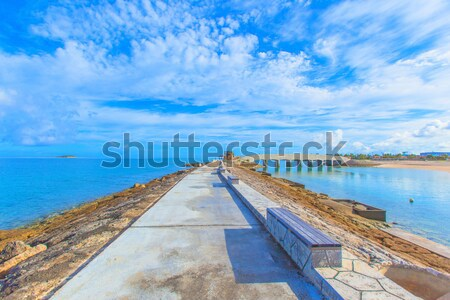 Breakwater with benches and bridge Stock photo © shihina