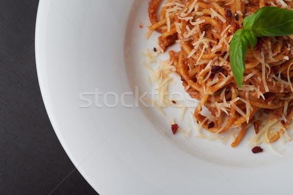 Espaguete manjericão folha parmesão restaurante macarrão Foto stock © shivanetua