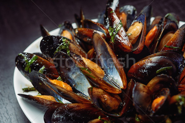 Seafood - Steamed Mussels on white plate Stock photo © shivanetua