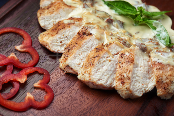 appetizing baked pieces of pork in mushroom sauce with cream Stock photo © shivanetua
