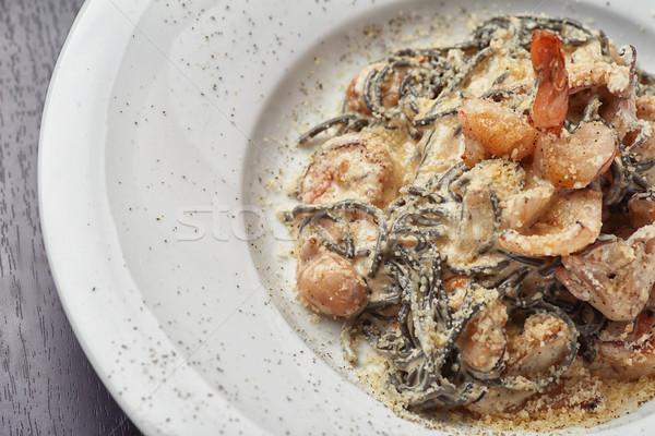 Italiano preto espaguete camarão polvo restaurante Foto stock © shivanetua