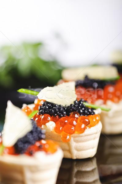 snacks with salmon roe Stock photo © shivanetua