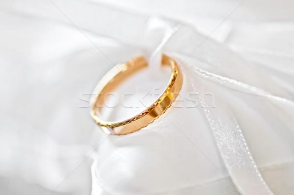 Wedding ring on a satiny fabric (macro) Stock photo © shivanetua