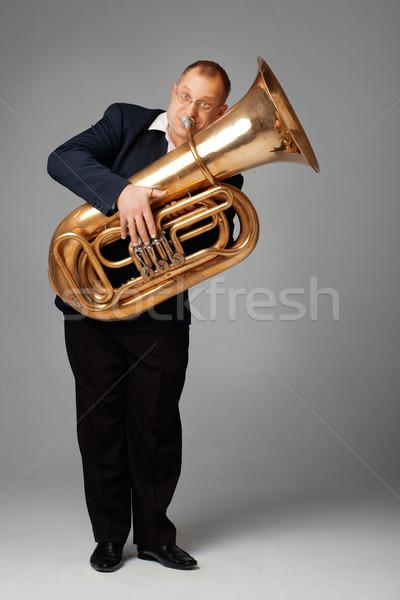 Zenész játszik tuba kéz arany dzsessz Stock fotó © shyshka