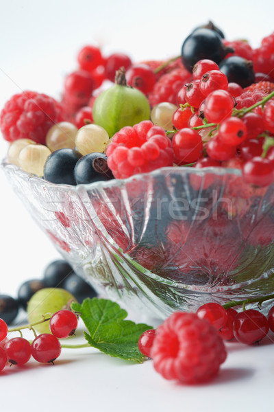 Splitted berries in a bowl Stock photo © shyshka
