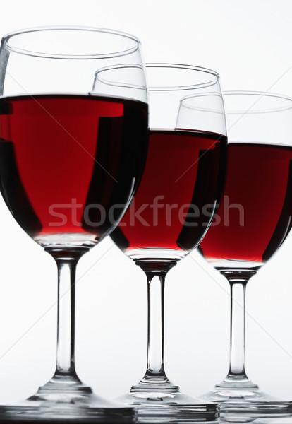 Három vörösbor szemüveg fókusz első üveg Stock fotó © shyshka