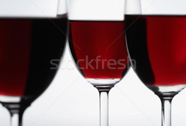Három vörösbor szemüveg fókusz középső üveg Stock fotó © shyshka