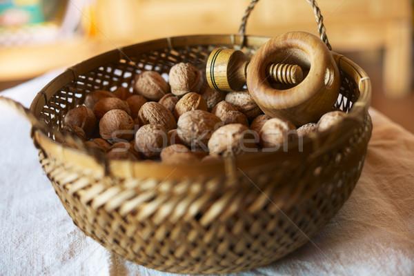 bowl of mixed walnuts with nutcracker Stock photo © shyshka