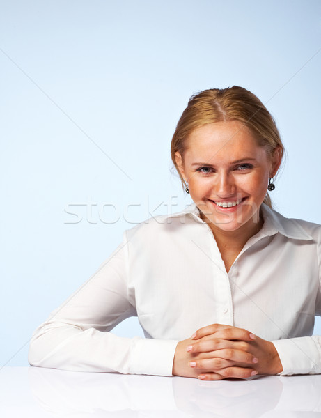 Image of a happy business woman smiling Stock photo © shyshka