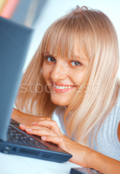 Close-up of a woman with laptop Stock photo © shyshka