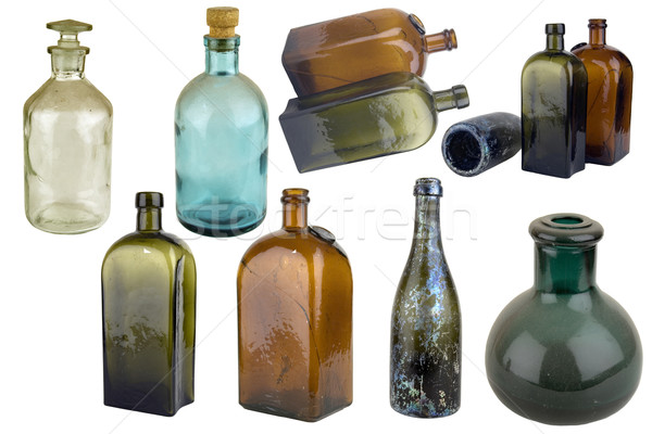 Antiquarian glass bottle Stock photo © sibrikov