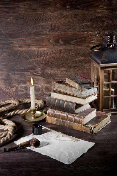 Naturaleza muerta edad objetos bronce candelero libro Foto stock © sibrikov