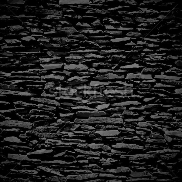Muro di pietra nero sollievo texture ombra costruzione Foto d'archivio © sidmay
