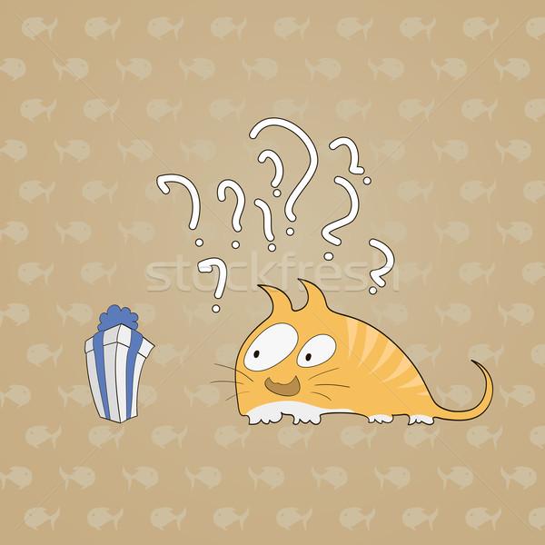 Сток-фото: удивленный · кошки · подарок · рыбы · вопросе · бумаги
