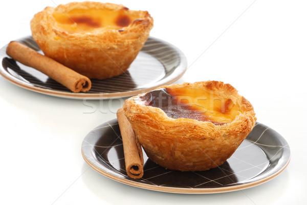 Custard Pies with cinnamon sticks Stock photo © simas2