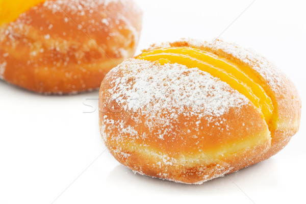 Two Berliner with egg creme over white Stock photo © simas2