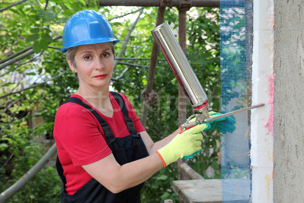 Yalıtım işçi köpük tutkal Stok fotoğraf © simazoran