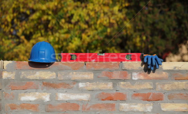 Construction worker equipment at brick wall Stock photo © simazoran