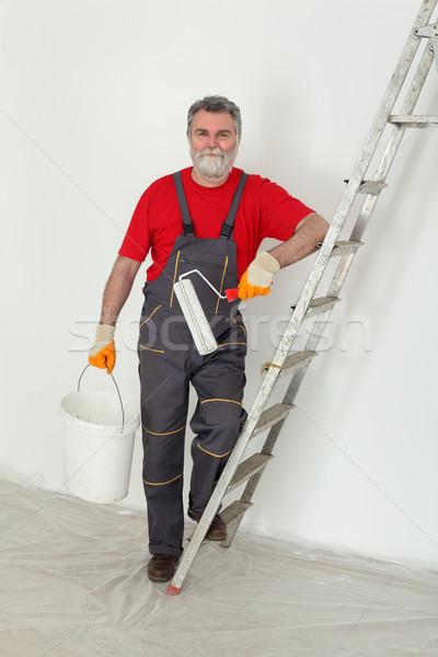 Worker painting  room to white Stock photo © simazoran