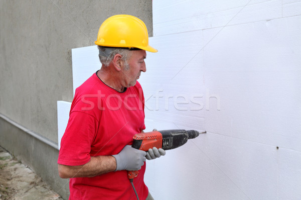 Construction site, styrofoam insulation drill for anchor Stock photo © simazoran