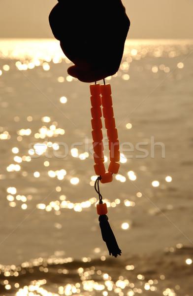 手 ロザリオ 海 日没 オレンジ 海 ストックフォト © simazoran