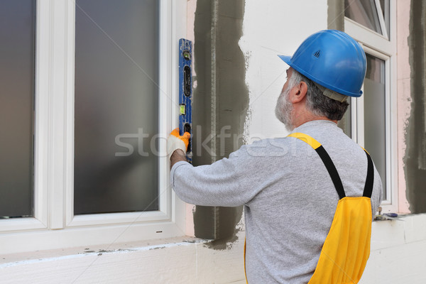 House renovation, polystyrene wall insulation, level tool Stock photo © simazoran