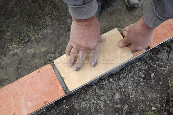Worker building brick wall Stock photo © simazoran