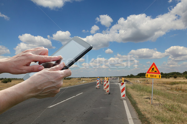 Worker inspecting highway or road in reconstruction Stock photo © simazoran