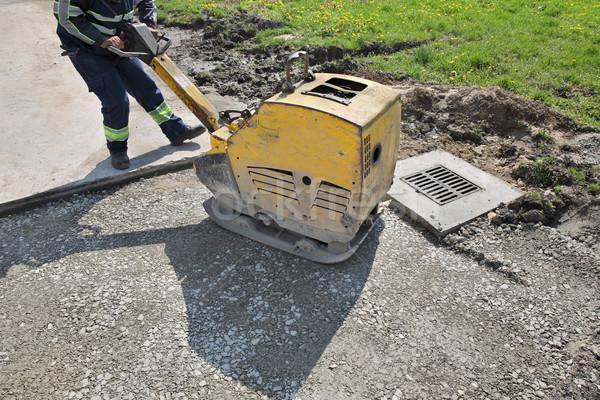 Munkás tányér útépítés helyszín kavicsút építkezés Stock fotó © simazoran