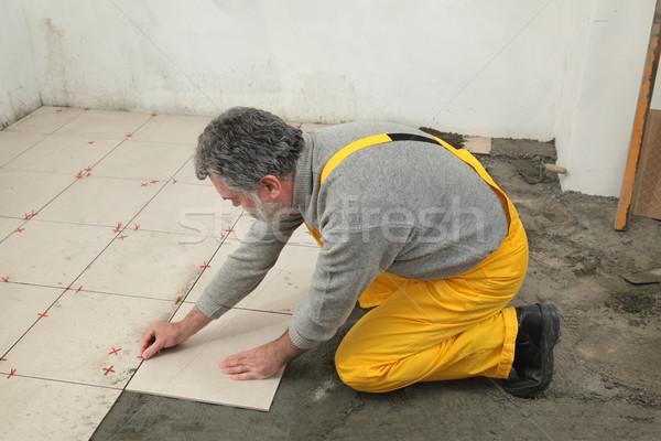 Otthon rendbehoz munkás csempe csempék padló Stock fotó © simazoran