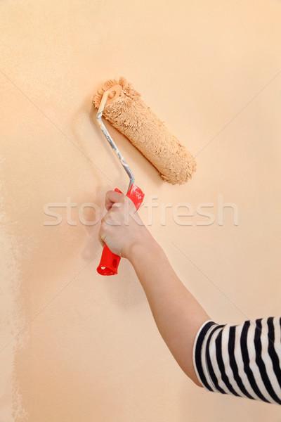 Worker hand with paintroller Stock photo © simazoran