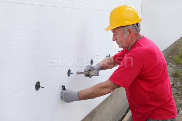 Yalıtım işçi çapa levha duvar Stok fotoğraf © simazoran
