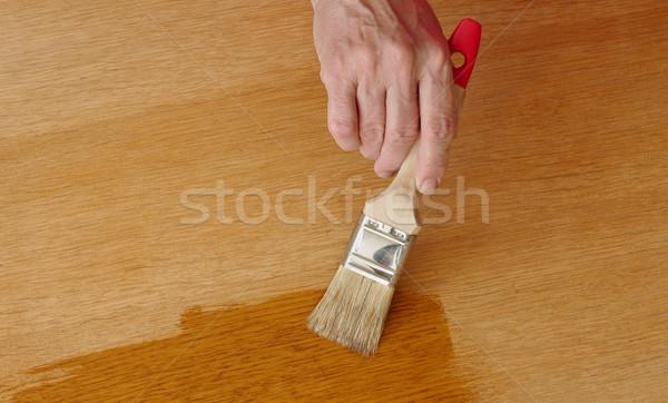Wooden plank varnishing Stock photo © simazoran
